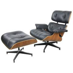 Herman Miller 670 Walnut Lounge and Ottoman by Charles and Ray Eames