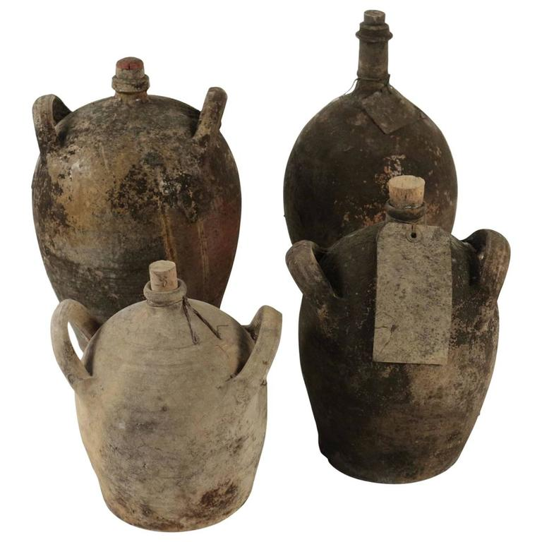 Collections of Empty Old Bottles in Terra Cotta