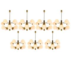 Seven Sputnik Chandeliers with Opaline Glass and Brass