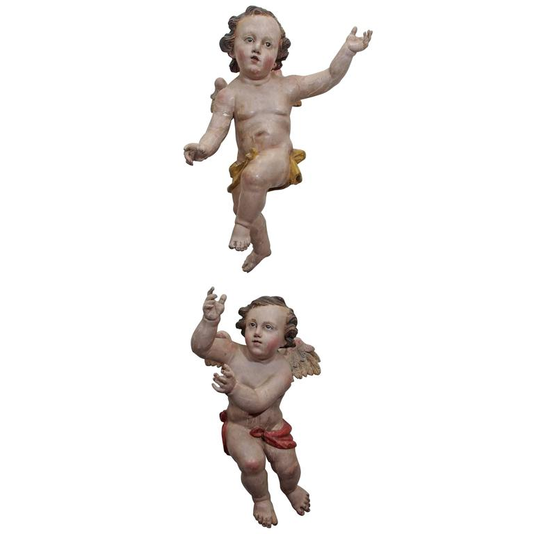 Pair of Painted Carved Wood Putti with Glass Eyes 1