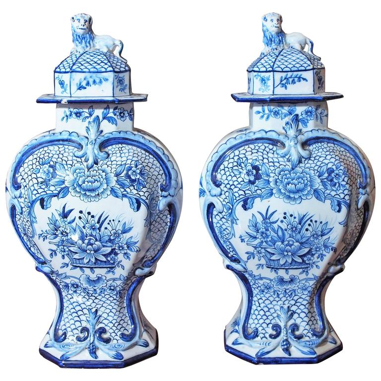 Pair of Delft Garniture Vases with Lion Finials 1