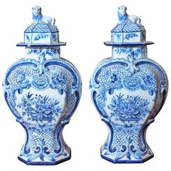 Pair of Delft Garniture Vases with Lion Finials
