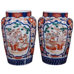 Pair of Imari ribbed jars with Small boys in a garden