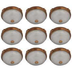Nine French 1940s Gilded Brass Flush Mounts