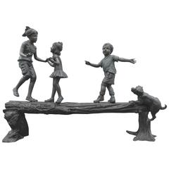 Bronze Statue of Three Children and a Puppy on a Log by AJ John