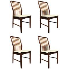 Four Svend Madsen Afromosia Wood and Leather Danish Dining Chairs