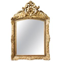 Italian Gilt Gesso Mirror Adorned with a Rocaille Crest, 18th Century