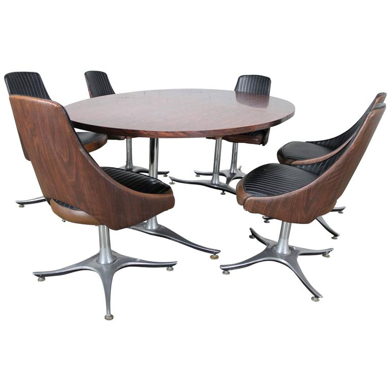 Mid-Century Dinette Set, Oval Double Pedestal Table with Six Swivel Chairs For Sale