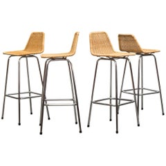 Set of Four Charlotte Perriand Style Wicker and Chrome Bar Stools