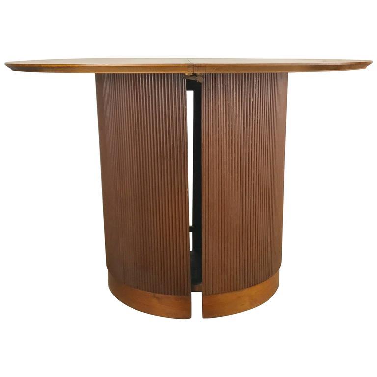 Unusual cylinder base round expandable dining table for for Unusual round dining tables