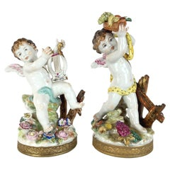 20th Century Polychrome Putti Pair o Figures European Pair of Porcelain Cherubs