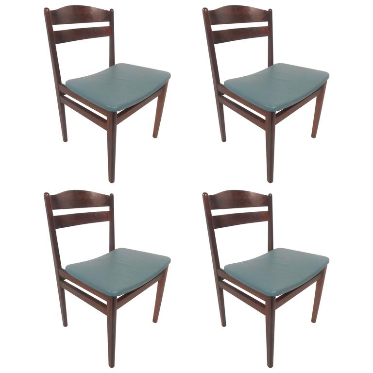 Set of Four Mid-Century Modern Danish Rosewood Dining Chairs with Leather Seats For Sale