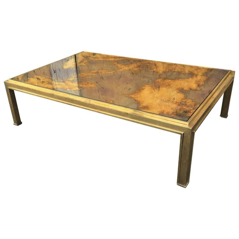 Jacques Adnet Sturdy Gold Bronze Big Coffee Table With A Gold Leaf Mirrored Top At 1stdibs