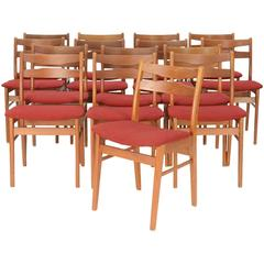 Upto 16 Danish Teak Dining Chairs with Mask Motif Backs and Danish Wool Seats