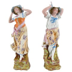Pair of 20th Century Italian Polychrome Biscuit Porcelain Figures of Two Girls
