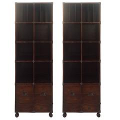 Pair of Theodore Alexander Campaign Style Leather Wrapped Bookshelves