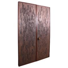 Double Sided Architectural Bronze Brutalist Doors by Forms and Surfaces