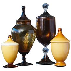 Set of Four Italian Lidded Glass Vessels in Caramel and Amber Tones, circa 1950