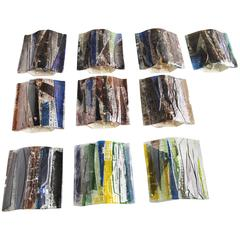 Ten '10' Brutalist Glass Sconces