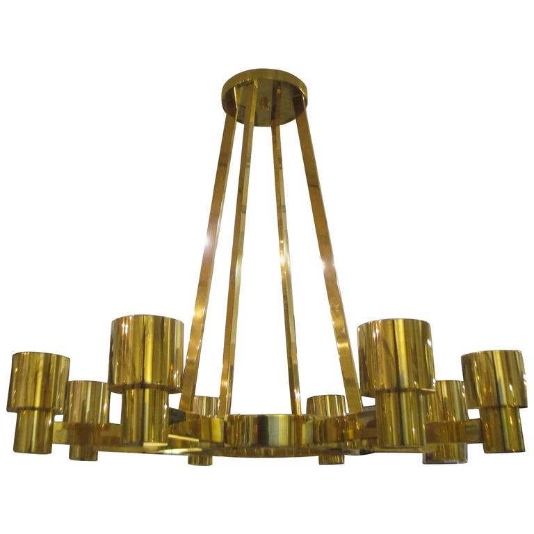 Custom sculptural brass chandelier with eight arms.