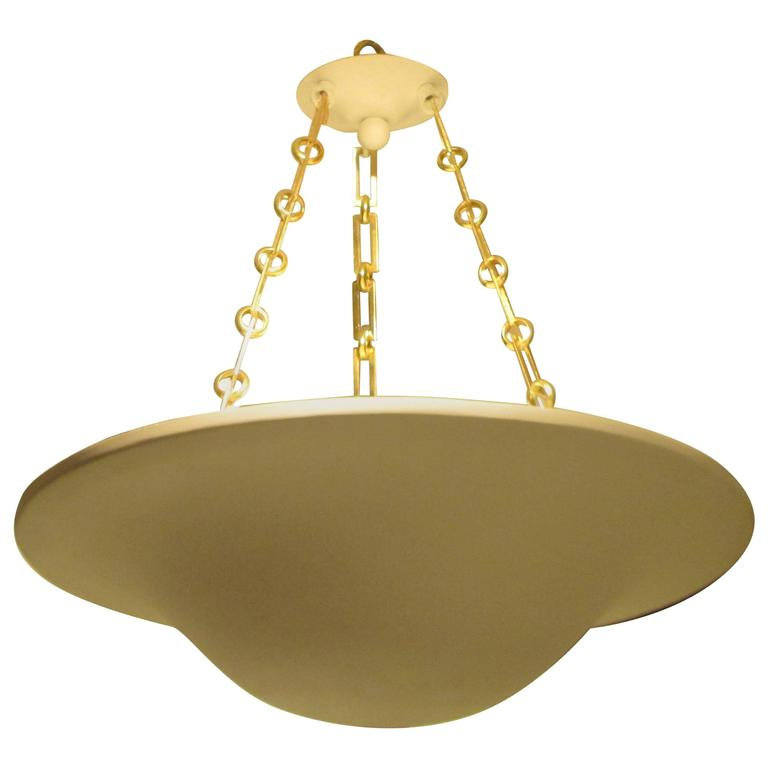 Custom plaster chandelier with brass chain.   Please note that this fixtures takes E-12 candelabra bulbs, 40 watts
