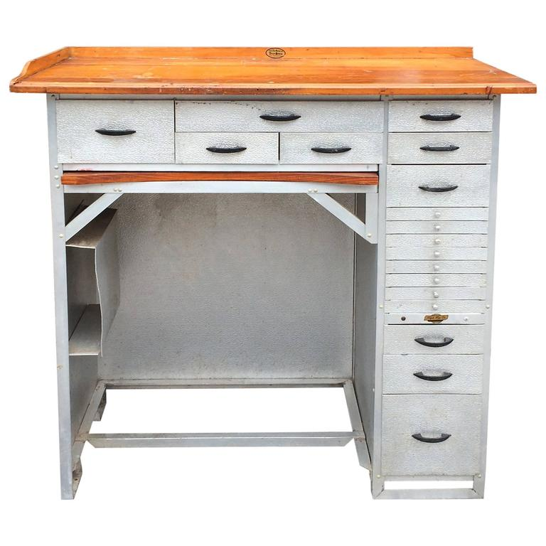 industrial stamped aluminum and maple watchmaker s desk at