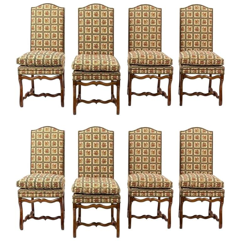 Set of eight Italian walnut and upholstered dining chairs, 20th century. Having upholstered backs and seats, with H-form stretchers.