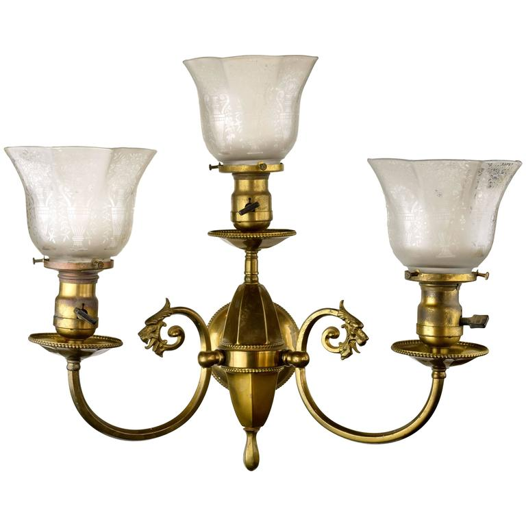 Beardslee Griffin Three-Arm Brass Sconce with shades