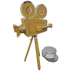 Leatherbound Movie Camera and Film Cans