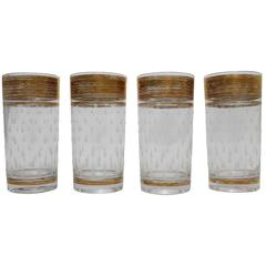 Four Mid-Century Hollywood Regency Glass Tumblers with Gold Trim and Teardrops