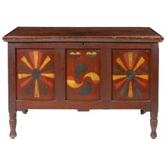 Red-Painted and Polychrome-Decorated Panelled Blanket Chest