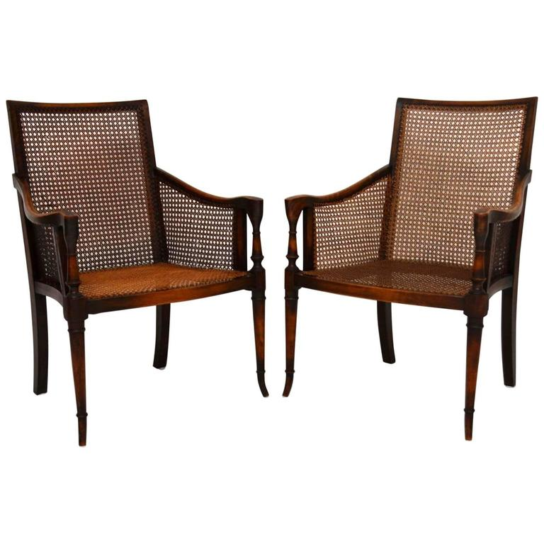 Pair Of Antique Mahogany And Cane Armchairs For Sale