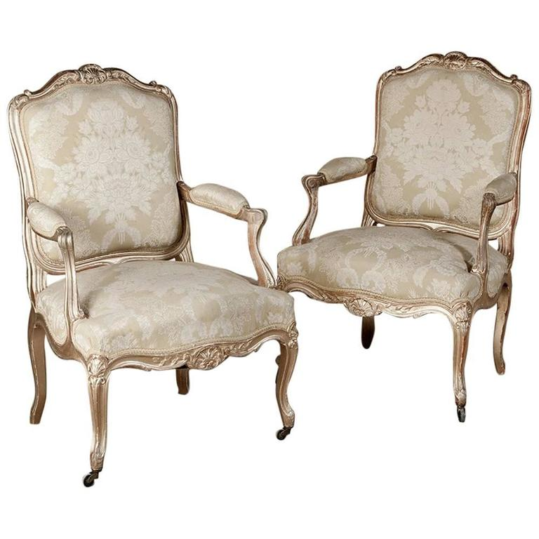 Pair of 19th Century Large Antique Italian Hand-Carved Giltwood Rococo Armchairs