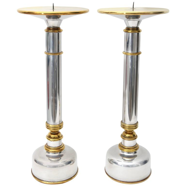 Pair of Polished Aluminium and Brass Candlesticks