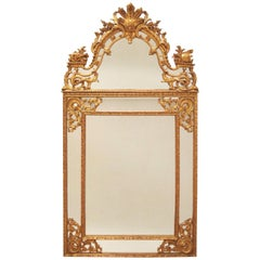 Large glazing beads Regence style mirror in carved and gilt wood, circa 1900