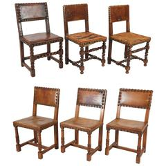 Antique Leather Chairs with Large Brass Nailheads