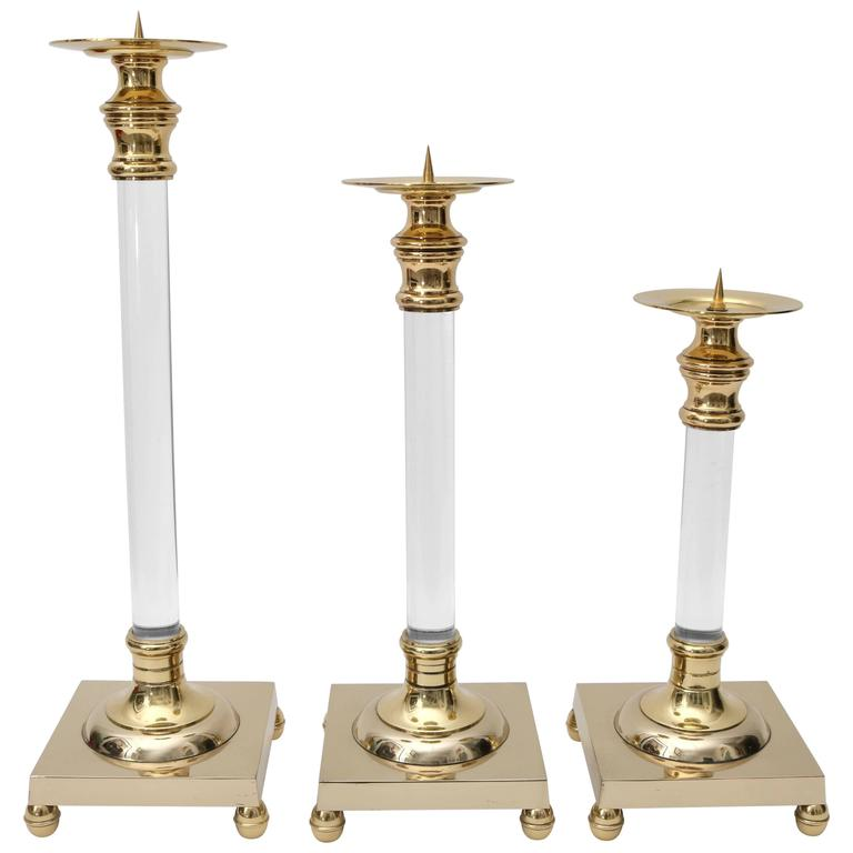 Set of Three Polished Brass and Lucite Candlesticks