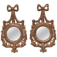 Pair of Carved Wood and Gilded Bow with Swag Mirrors