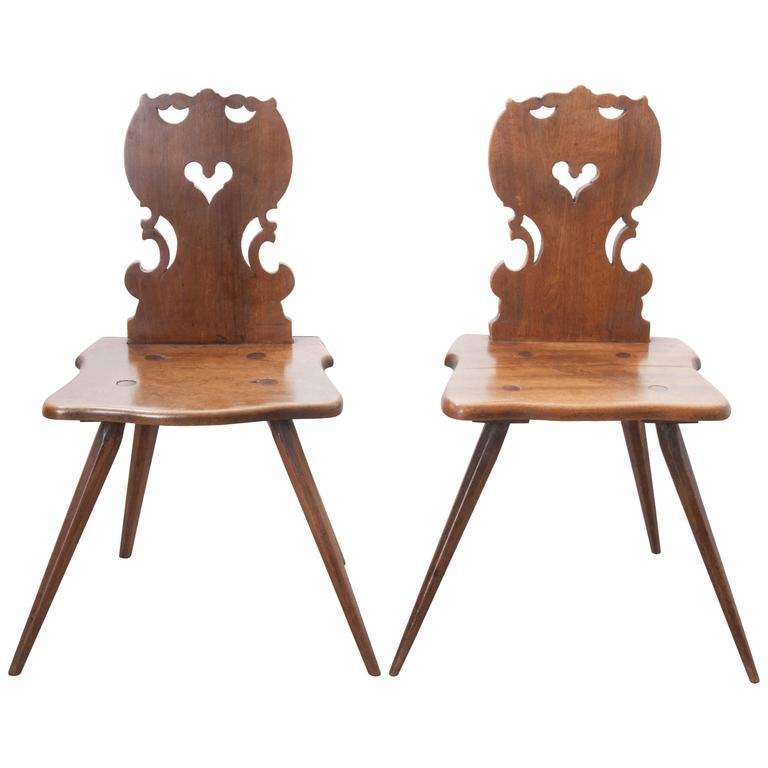 Pair of early 19th century hand carved alsatian chairs for sale