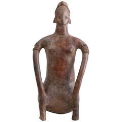 Pottery Figure of a Seated Female