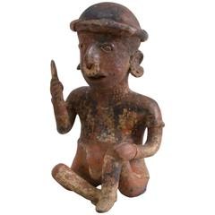 Painted Pottery Figure of a Seated Male