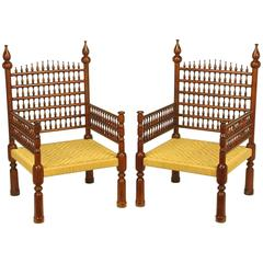 Pair of Grand Scale Moroccan Teak Open Fretwork and Rush Armchairs