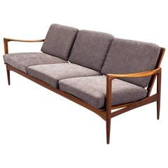 Ib Kofod-Larsen 1960s Kandidaten Sofa in teak and fabric produced by OPE Mobler