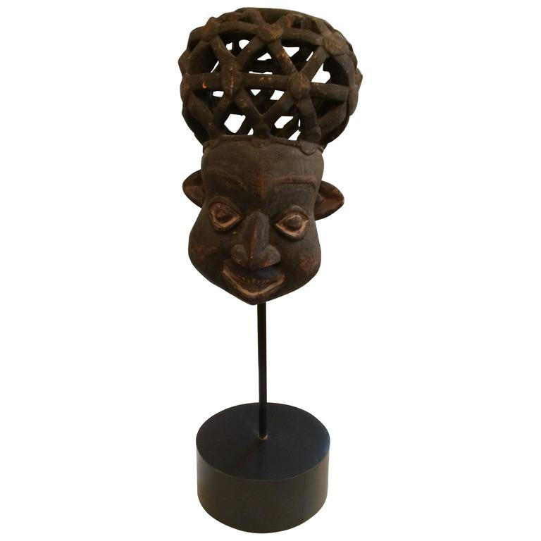 African Sculpture: Bold African Sculpture Of A Head On Custom Stand For Sale