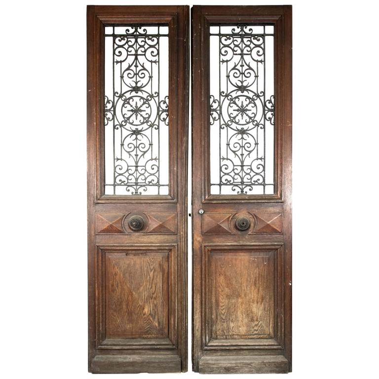 Pair of french cast iron and oak front doors at 1stdibs for Oak french doors