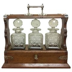 Late Victorian Gothic and Aesthetic Oak Triple Decanter Set