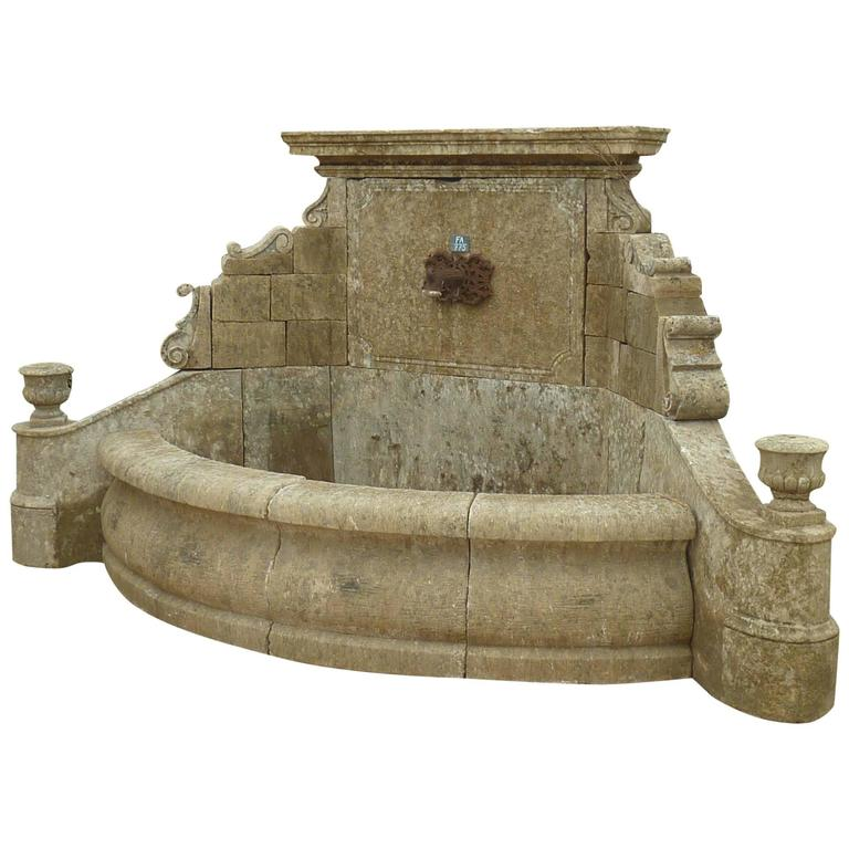 Unique Wall-Fountain Carved in French Limestone with Curved Basin and Sculptures