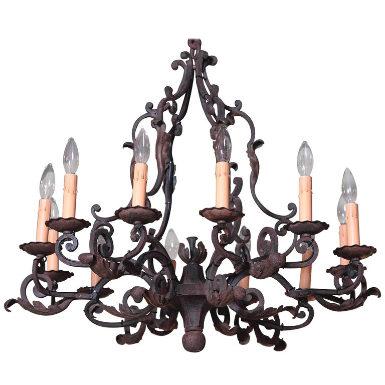Early 20th Century French Verdigris Ten-Light Iron Chandelier For Sale