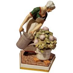 "Porcelain Danish Figurine ""Girl Watering Hydrangea Plant with Cat"""