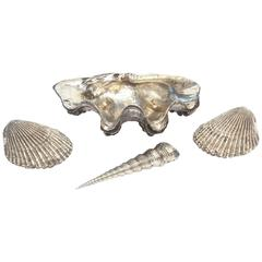 Collection of Four White Bronze Assorted Shells